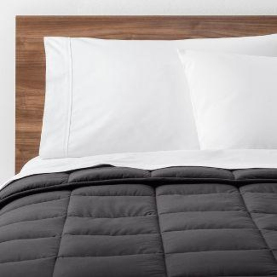 Photo - Solid down alternative comforter by Made By Design, a new home line launching June 23 at Target.