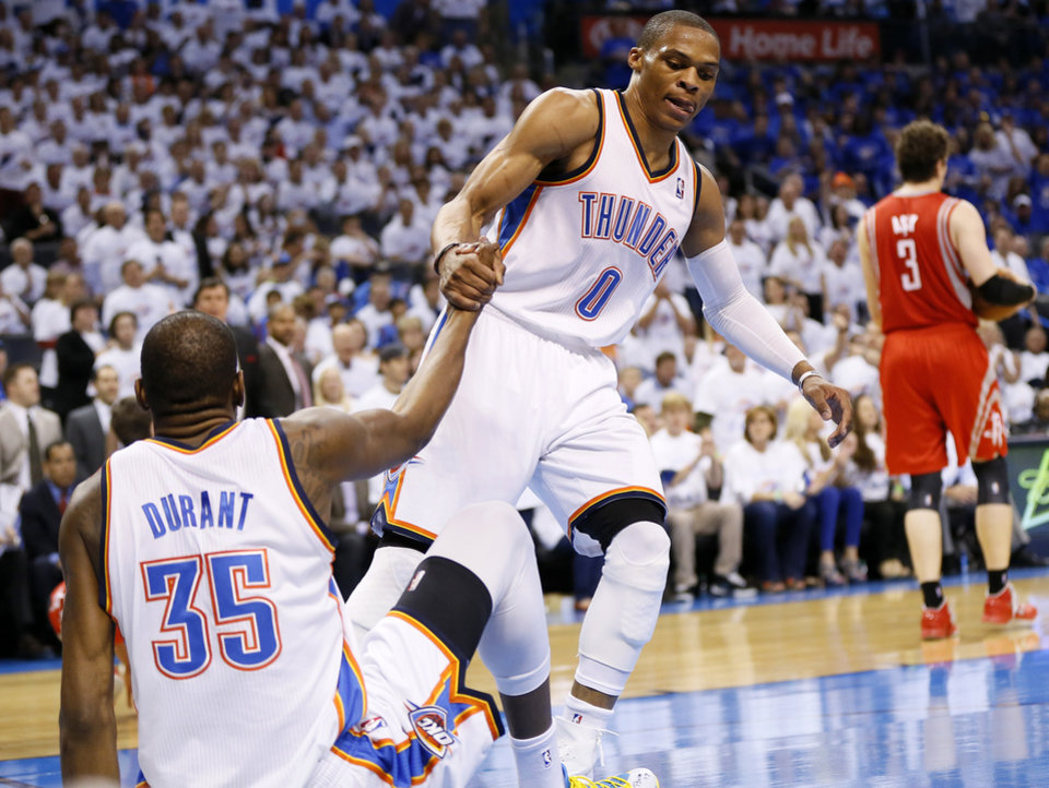 Photo - Oklahoma City's Russell Westbrook (0) helps Kevin Durant (35) up off the court after being knocked down during Game 2 in the first round of the NBA playoffs between the Oklahoma City Thunder and the Houston Rockets at Chesapeake Energy Arena in Oklahoma City, Wednesday, April 24, 2013. Oklahoma City won, 105-102. Photo by Nate Billings, The Oklahoman