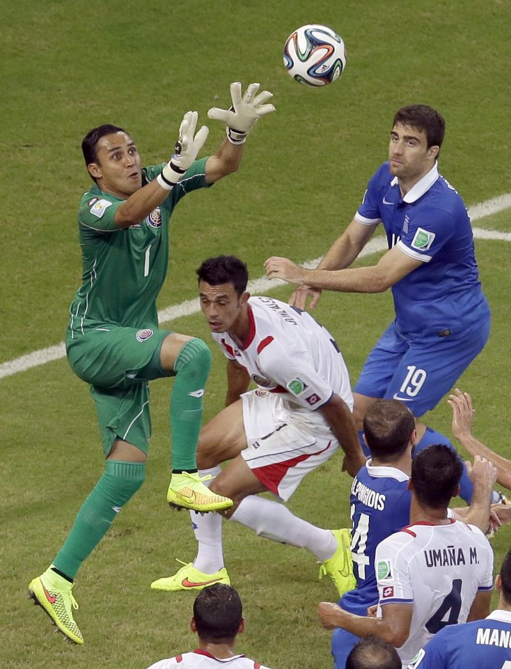 Photo - Costa Rica's goalkeeper Keylor Navas makes a save during the World Cup round of 16 soccer match between Costa Rica and Greece at the Arena Pernambuco in Recife, Brazil, Sunday, June 29, 2014. (AP Photo/Hassan Ammar)
