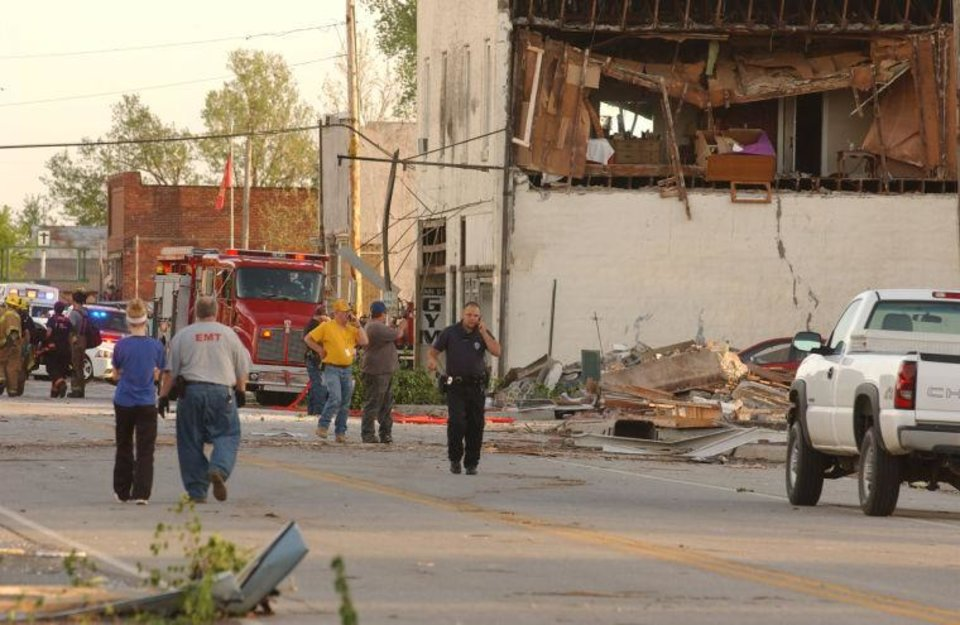 Photo -  First responders, volunteers and firemen gather on Main Street in Quapaw after a tornado struck the city on Sunday evening. GARY CROW, For the Tulsa World      -