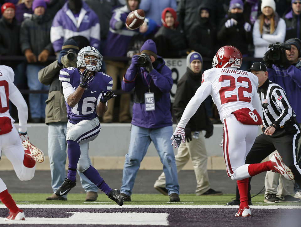 Kansas State's Tyler Lockett (16) catches a touchdown pass in front of Oklahoma's Cortez Johnson (22) during an NCAA college football game between the Oklahoma Sooners and the Kansas State University Wildcats at Bill Snyder Family Stadium in Manhattan, Kan., Saturday, Nov. 23, 2013. Oklahoma won 41-31. Photo by Bryan Terry, The Oklahoman