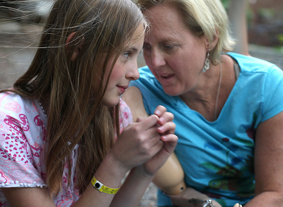 Photo -       Lisa Speckman sits with daughter Hannah in Salt Lake City on Monday, May 5, 2014.