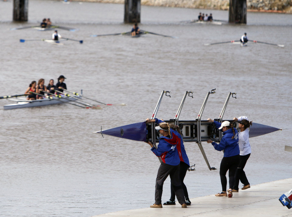 Photo - The Texas Rowing A team places their rowing shell into the water during the Oklahoma Regatta Festival on the Oklahoma River in Oklahoma City, OK, Saturday, October 5, 2013,  Photo by Paul Hellstern, The Oklahoman