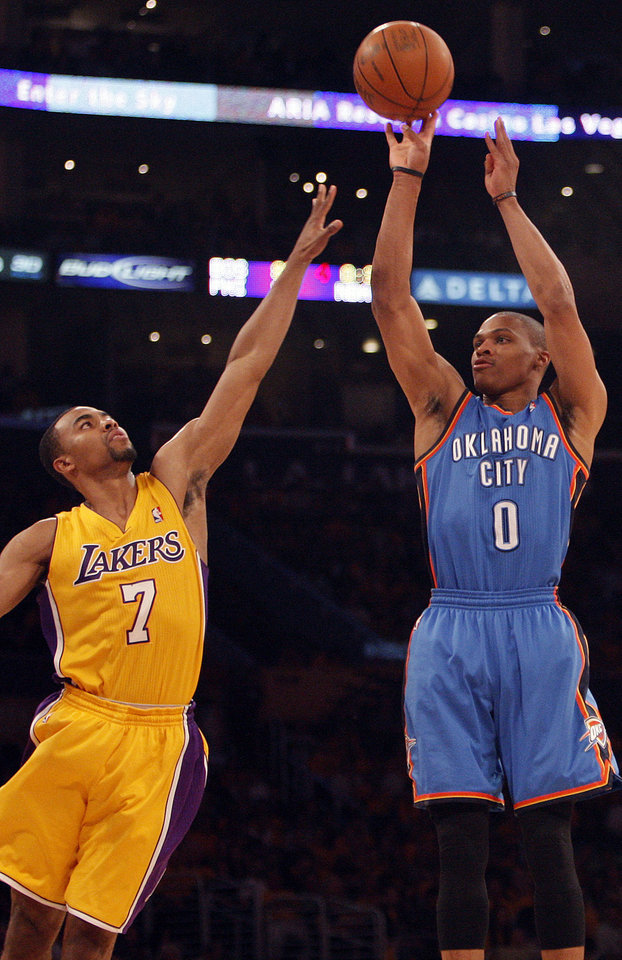 Oklahoma City's Russell Westbrook (0) shoots over Los Angeles' Ramon Sessions (7) during Game 3 in the second round of the NBA basketball playoffs between the L.A. Lakers and the Oklahoma City Thunder at the Staples Center in Los Angeles, Friday, May 18, 2012. Photo by Nate Billings, The Oklahoman
