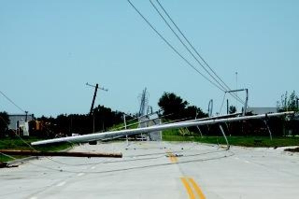 Photo - Power lines down on Radio Road near Performance Technologies, just south of Interstate 40. The new PT building was also damaged in the May 31 tornado. Traci Chapman