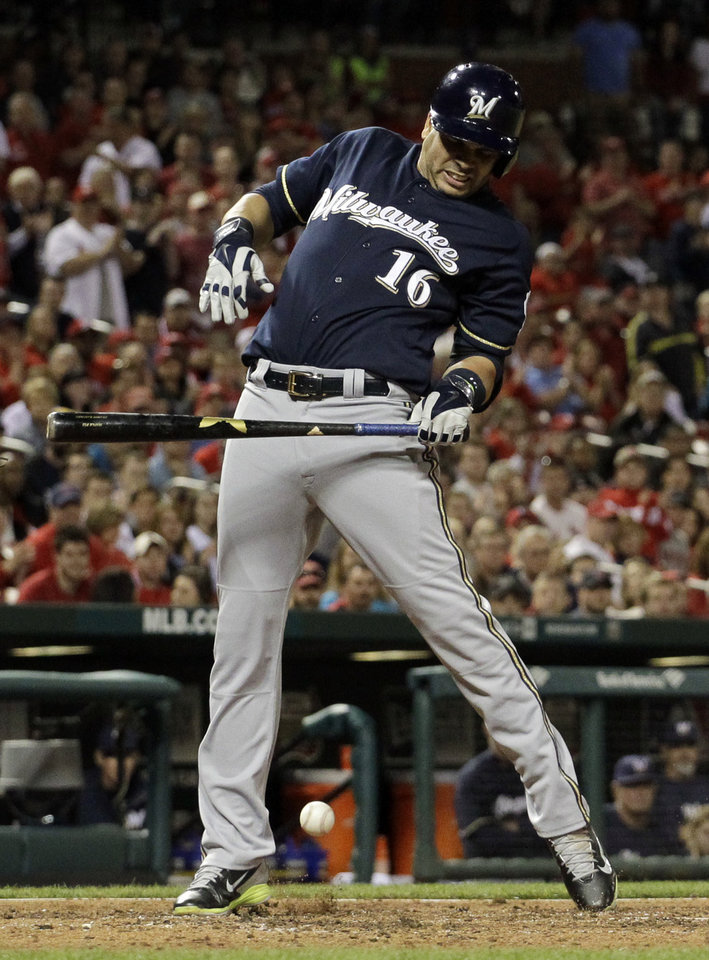 Photo - Milwaukee Brewers' Aramis Ramirez is hit by a pitch with the bases loaded during the seventh inning of a baseball game against the St. Louis Cardinals on Monday, April 28, 2014, in St. Louis. (AP Photo/Jeff Roberson)
