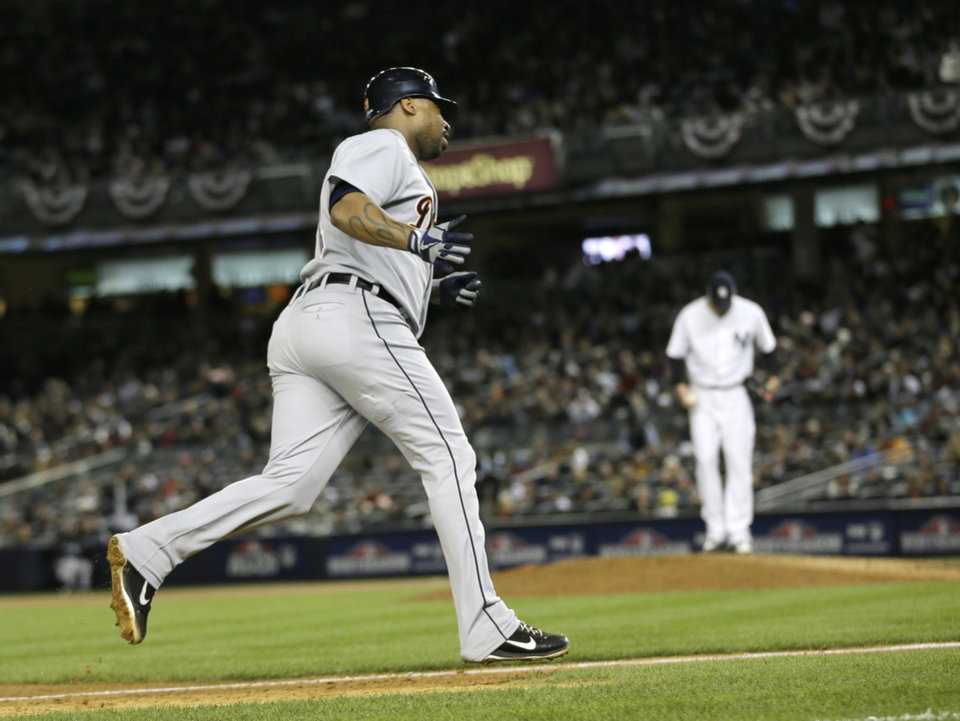 Detroit Tigers' Delmon Young rounds third base after hitting a solo home run off New York Yankees' Derek Lowe, rear, in the eighth inning during Game 1 of the American League championship series Saturday, Oct. 13, 2012, in New York. (AP Photo/Matt Slocum)