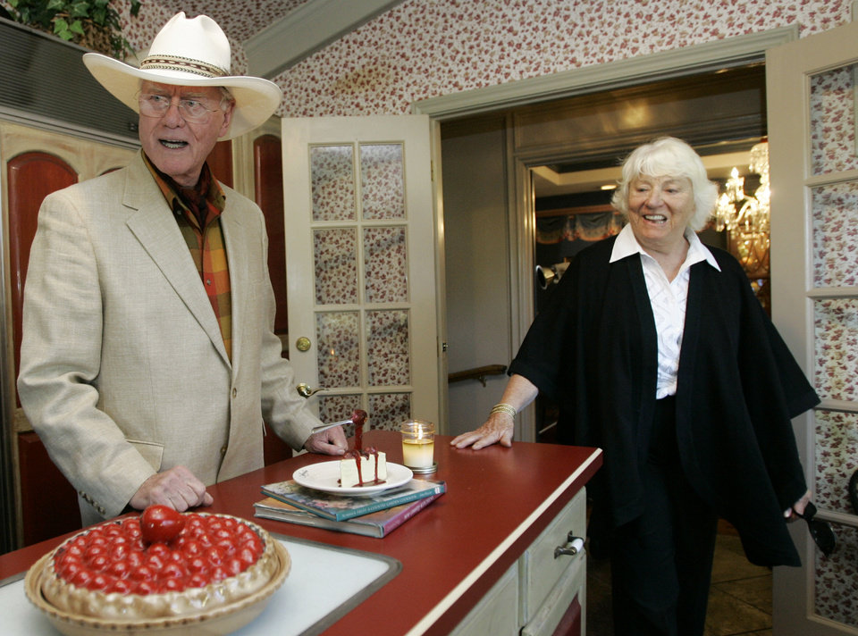 Photo -   FILE - In this Thursday, Oct. 9, 2008 file photo, actor Larry Hagman and his wife Maj, visit the kitchen area of the Southfork Ranch mansion in Parker, Texas made famous in the television show