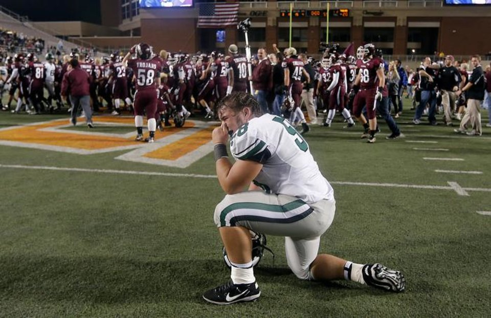 Norman North's Collin Power (58) reacts after the loss to Jenks during the Class 6A Oklahoma state championship football game between Norman North High School and Jenks High School at Boone Pickens Stadium on Friday, Nov. 30, 2012, in Stillwater, Okla.   Photo by Chris Landsberger, The Oklahoman