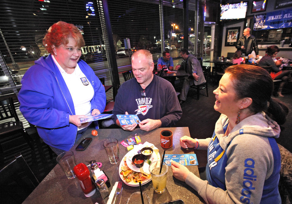 Lisa Warren hands out party favors at a Blue Alliance watch party in Yukon, Tuesday, January 15, 2013. Blue Alliance is an organization of Oklahoma City Thunder fans that meet across the state to watch the games.  Photo By David McDaniel/The Oklahoman