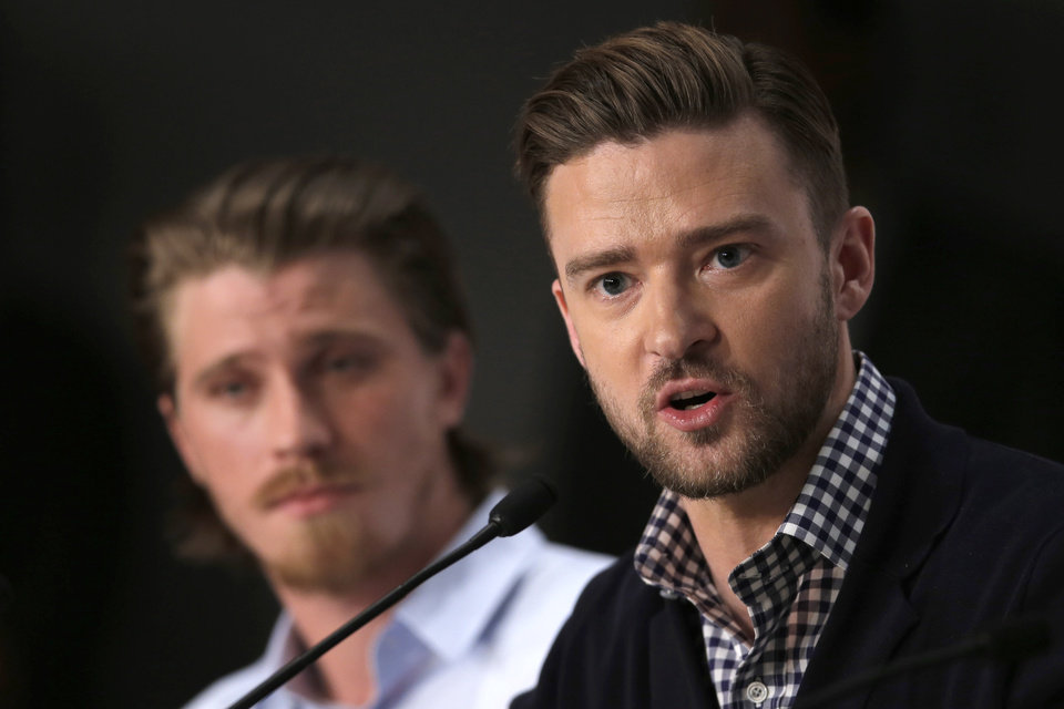 Photo - Actor Justin Timberlake, right, speaks as actor Garrett Hedlund listens during a press conference for Inside Llewyn Davis at the 66th international film festival, in Cannes, southern France, Sunday, May 19, 2013. (AP Photo/Francois Mori)