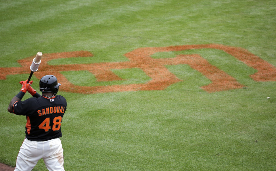 Photo - San Francisco Giants' Pablo Sandoval warms up during the fifth inning of a spring training baseball game against the Cincinnati Reds in Scottsdale, Ariz., Thursday, March 6, 2014. (AP Photo/Chris Carlson)