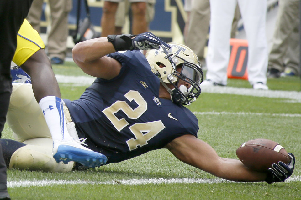 Photo - Pittsburgh running back James Conner (24) score his second touchdown of the first quarter in an NCAA college football game against Delaware on Saturday, Aug. 30, 2014, in Pittsburgh. (AP Photo/Keith Srakocic)