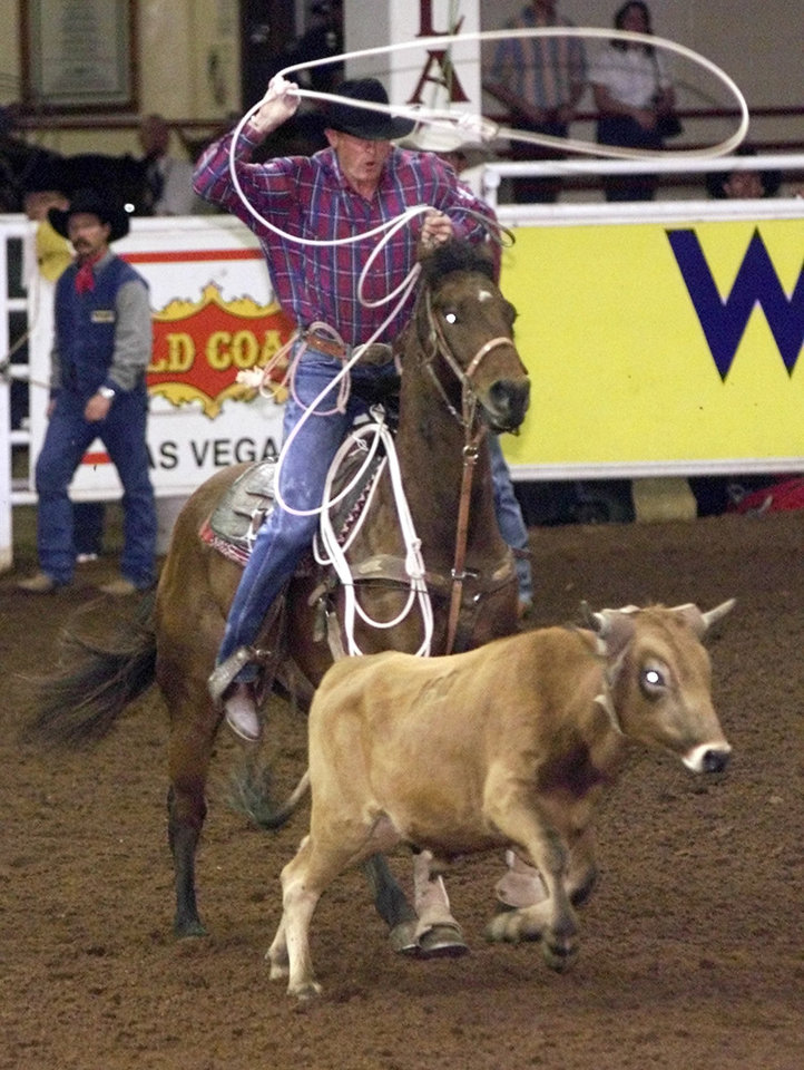 Photo - Roy Cooper of Childress, Tx during the first round of the National Finals Steer Roping.