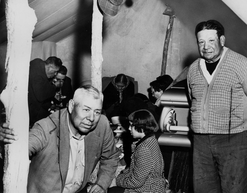 Photo - After Jim Thorpe's death, a feast was held in his honor. This 1953 photo was taken at the feast, spread in front of Thorpe's casket near Shawnee.  THE OKLAHOMAN ARCHIVE  UNKNOWN - The Oklahoma City Times Staff Ph