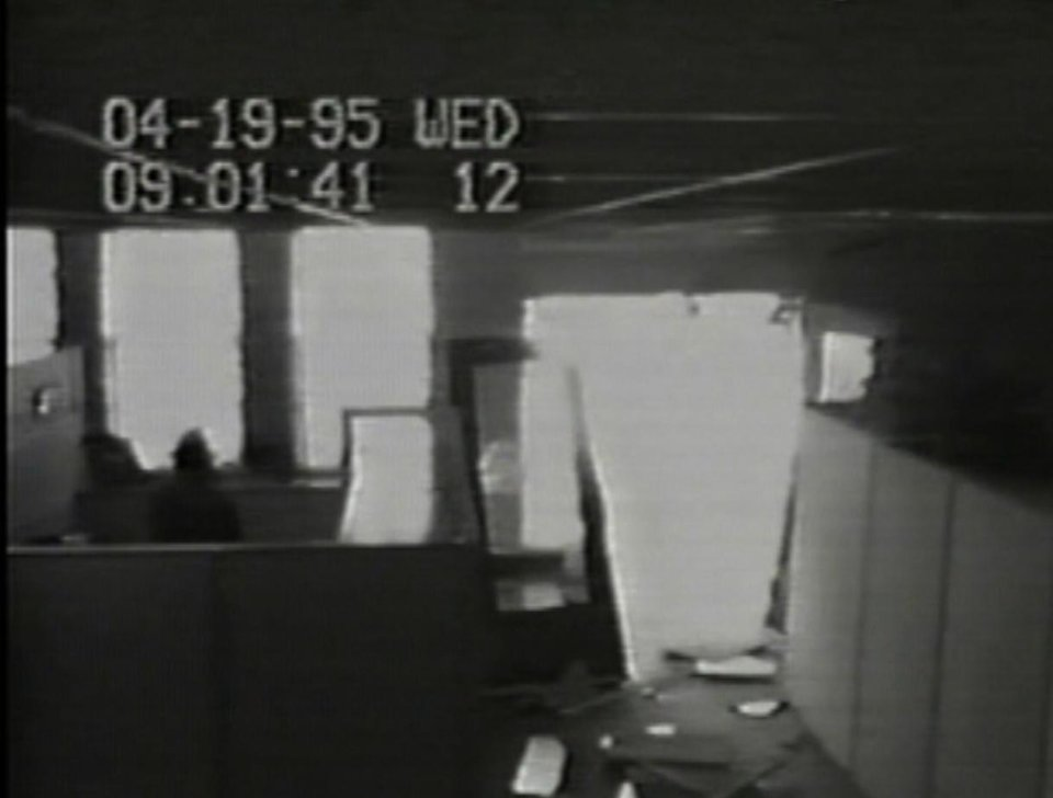 Photo - ALFRED P. MURRAH FEDERAL BUILDING / CAR / TRUCK / BOMB / EXPLOSION / VIDEO CLIP / SCREEN SHOT / VIDEO SURVEILLANCE CAMERA FOOTAGE:  A Southwestern Bell security camera shows damage to an  entrance of the company's building after the explosion. The time on the recording is slightly behind the established time of the bombing. - IMAGE PROVIDED BY JESSE TRENTADUE   ORG XMIT: 0909272156405905
