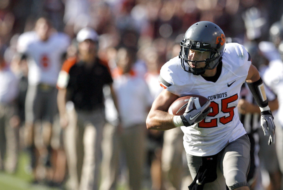 Oklahoma State\'s Josh Cooper runs up field in the second half of OSU\'s win over Texas A&M on Saturday. Photo by Sarah Phipps, The Oklahoman
