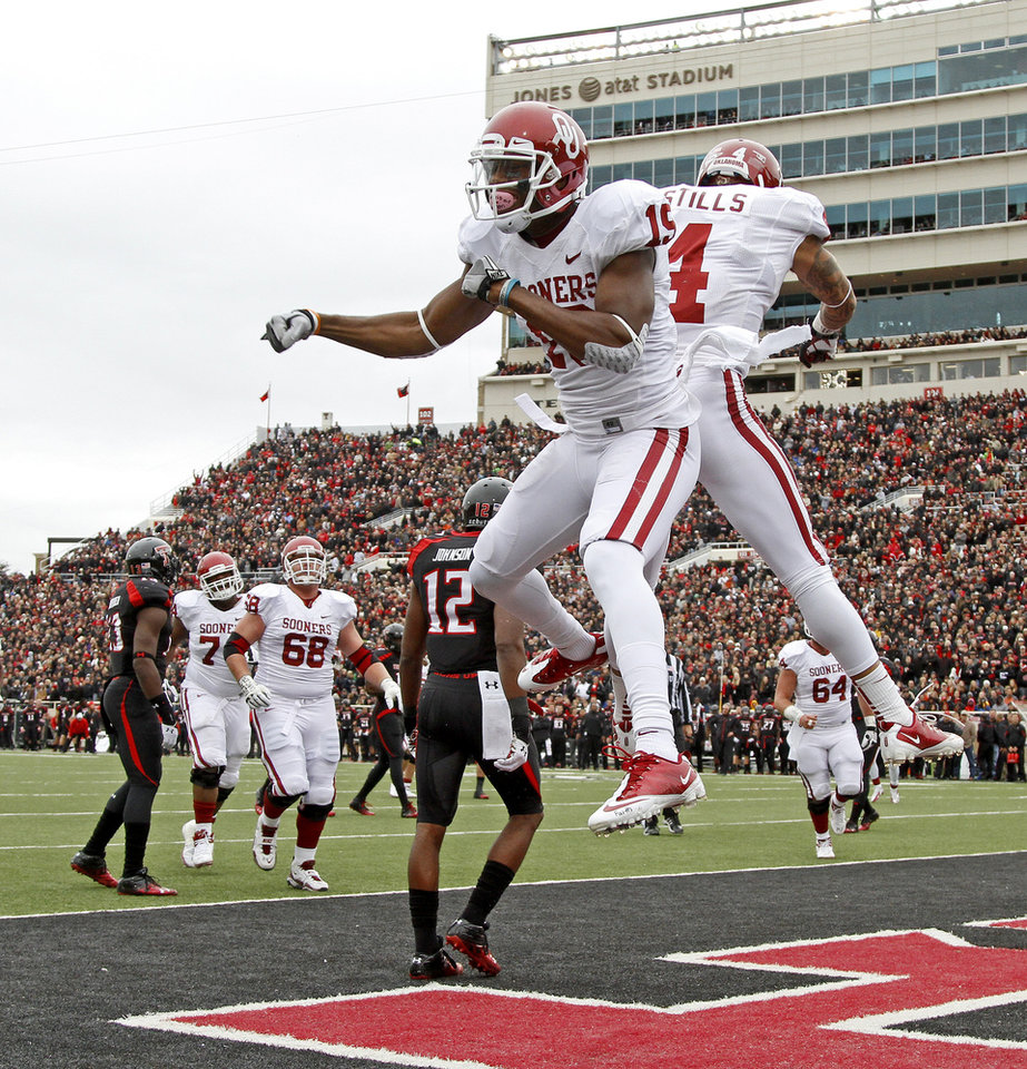 Photo - Oklahoma's Justin Brown (19) celebrates with Kenny Stills (4) after Brown scored a touchdown during a college football game between the University of Oklahoma (OU) and Texas Tech University at Jones AT&T Stadium in Lubbock, Texas, Saturday, Oct. 6, 2012. Photo by Bryan Terry, The Oklahoman