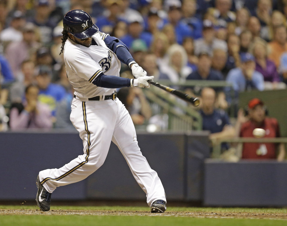 Photo - Milwaukee Brewers' Rickie Weeks hits a run-scoring single against the New York Yankees in the seventh inning of a baseball game Saturday, May 10, 2014, in Milwaukee. (AP Photo/Jeffrey Phelps)