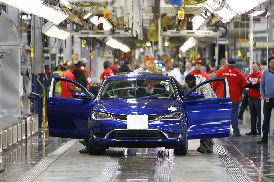 Photo -  In this March 14 photo, a 2015 Chrysler 200 automobile moves down the assembly line at the Sterling Heights Assembly Plant in Sterling Heights, Mich. Automakers reported high sales for May on Tuesday. AP Photo   Paul Sancya -  AP