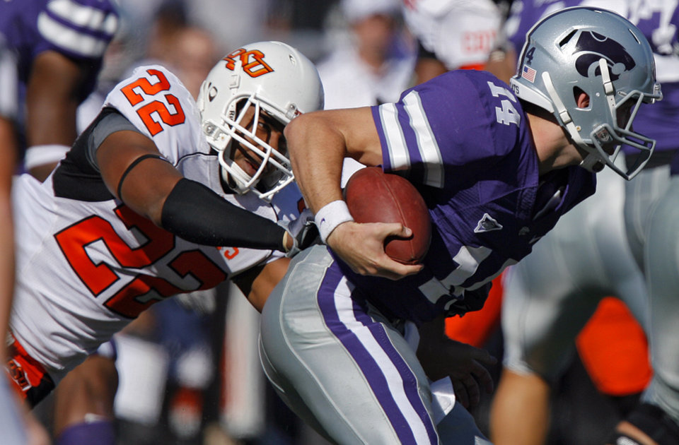 Oklahoma State's James Thomas (22) brings down Kansas State quarterback Carson Coffman (14) during the first half of the college football game between the Oklahoma State University Cowboys (OSU) and the Kansas State University Wildcats (KSU) on Saturday, Oct. 30, 2010, in Manhattan, Kan.   Photo by Chris Landsberger, The Oklahoman
