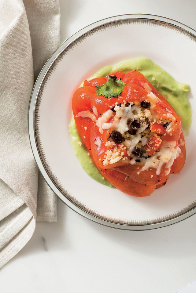 Photo - With a new year, many people vow to adopt better eating habits. One dish along those lines is  stuffed red bell peppers with whole-wheat couscouse and avocado sauce from Giada de Laurentis'