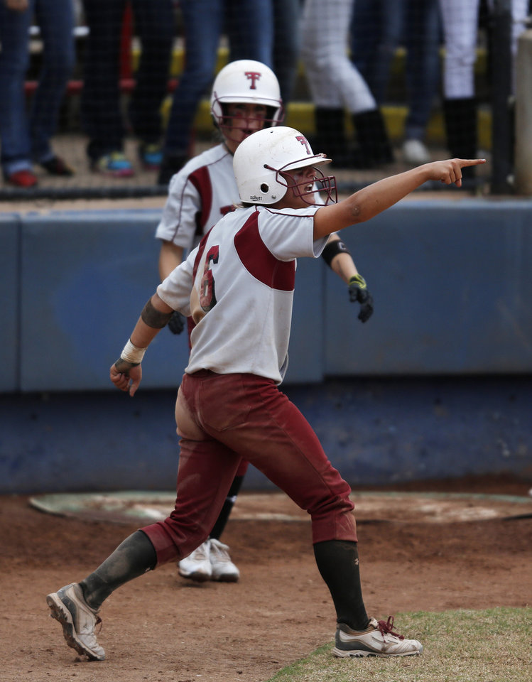 Tuttle\'s Shelby Carel (6) celebrates after scoring a run during the 4A state softball semifinals game between Oolagah-Talala and Tuttle at ASA Hall of Fame Stadium in Oklahoma City, Okla., Friday, Oct. 12, 2012. Photo by Garett Fisbeck, The Oklahoman