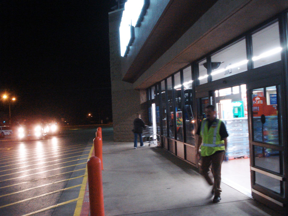 Photo - The Elk City Walmart doorway is shown about 4:30 a.m. Friday. It is empty because, unlike previous years, the store did not close in advance of the 5 a.m. sale. By Jim Stafford,  for the oklahoman