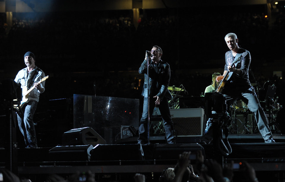 Photo - From left, guitarist The Edge, singer Bono, drummer Larry Mullen Jr. and bassist Adam Clayton of the rock band  U2 perform during their 360 world tour stop at Giants Stadium in East Rutherford, NJ on Thursday, Sept. 24, 2009. (AP Photo/Evan Agostini)