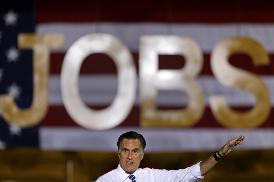 Republican presidential candidate, former Massachusetts Gov. Mitt Romney gestures as he speaks at a campaign event at Screen Machine Industries, Friday, Nov. 2, 2012, in Etna, Ohio. (AP Photo/David Goldman)
