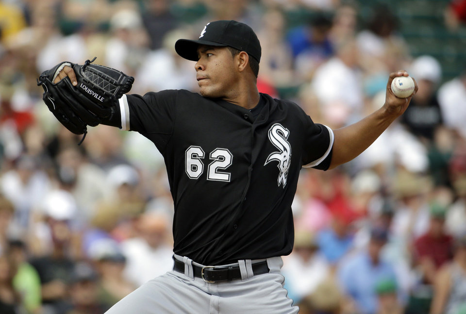 Photo - Chicago White Sox's Jose Quintana throws before an exhibition spring baseball game against the Los Angeles Angels, Thursday, March 13, 2014, in Tempe, Ariz. (AP Photo/Morry Gash)