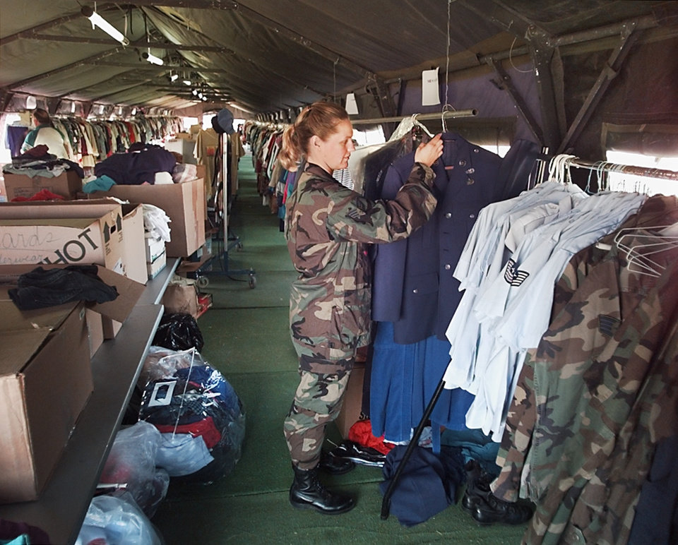 Donations: Relief volunteer Senior Airman Danna Ward of the 963rd AWACS inside one of the two  500 foot long tents set up at tinker for clothes that have been donated for tornado victims.