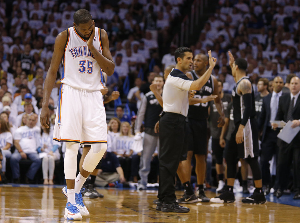 Photo - Oklahoma City's Kevin Durant (35) reacts after being called for a foul on a San Antonio's Danny Green (4) 3-point shot during Game 6 of the Western Conference Finals in the NBA playoffs between the Oklahoma City Thunder and the San Antonio Spurs at Chesapeake Energy Arena in Oklahoma City, Saturday, May 31, 2014. Photo by Bryan Terry, The Oklahoman