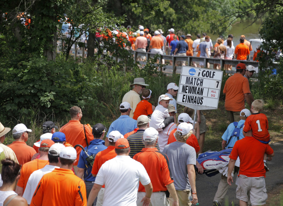 Photo - COLLEGE GOLF / OSU / NCAA GOLF TOURNAMENT: Golf fans walk to the green of No. 18 to watch the decisive match between OSU's Sean Einhaus and Augusta State's Carter Newman during the team match semifinals of the NCAA Division I Men's Golf Championship at Karsten Creek in Stillwater, Okla., Saturday, June 4, 2011.  Newman beat Einhaus on a playoff hole to give Augusta State the win over Oklahoma State University. Photo by Nate Billings, The Oklahoman ORG XMIT: KOD