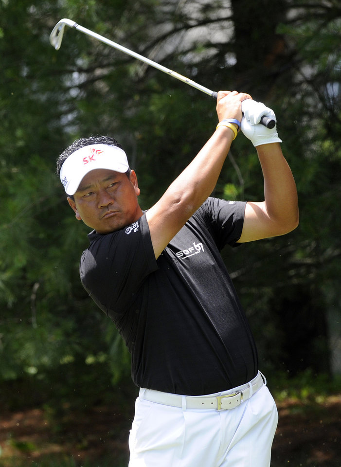 Photo - K.J. Choi watches his tee shot on the eighth hole during the second round of the Travelers Championship golf tournament in Cromwell, Conn., Friday, June 20, 2014. (AP Photo/Fred Beckham)