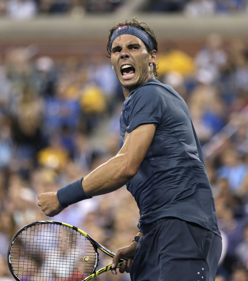 Rafael Nadal, of Spain, celebrates after defeating Phillipp Kohlschreiber, of Germany, during the fourth round of the 2013 U.S. Open tennis tournament, Monday, Sept. 2, 2013, in New York. (AP Photo/Charles Krupa)