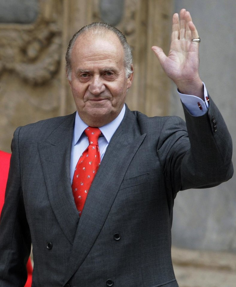 Photo - FILE - In this file photo from April 12, 2009, Spanish King Juan Carlos, waves after attending an Easter Mass at the Cathedral of Palma de Mallorca, Spain. Spanish Prime Minister Mariano Rajoy said Monday June 2, 2014 that King Juan Carlos plans to abdicate and pave the way for his son, Crown Prince Felipe, to become the country's next king. The 76-year-old Juan Carlos oversaw his country's transition from dictatorship to democracy but has had repeated health problems in recent years. His popularity also dipped following royal scandals, including an elephant-shooting trip he took in the middle of Spain's financial crisis that tarnished the monarch's image. The king came to power in 1975, two days after the death of longtime dictator Francisco Franco. (AP Photo/Manu Mielniezuk, File)