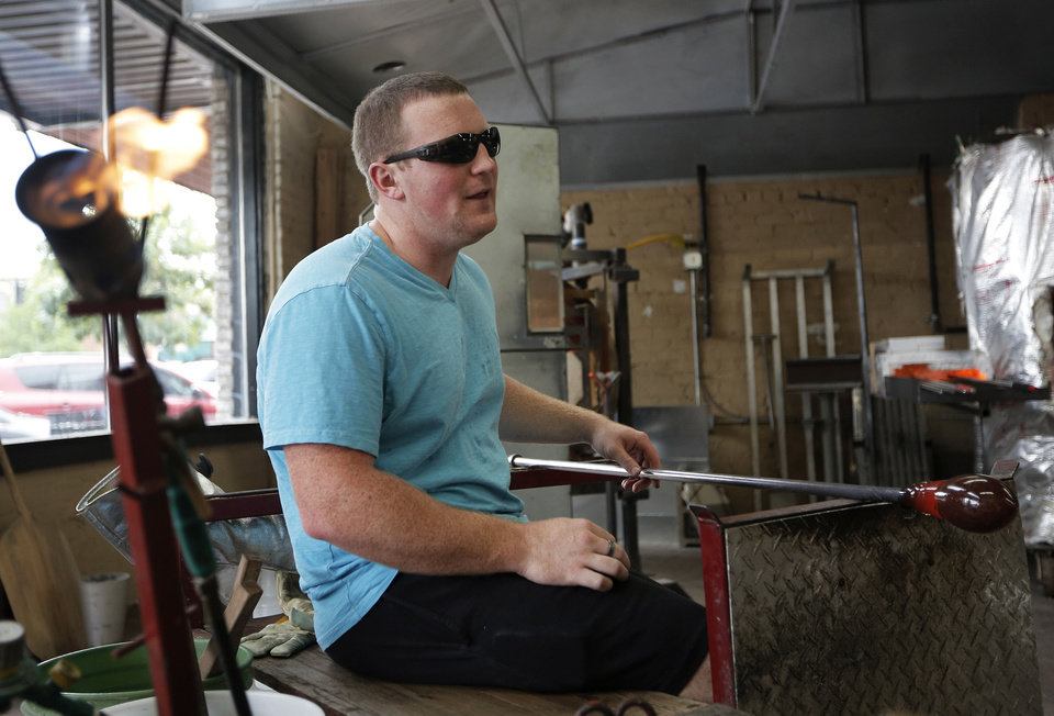 Bobby Bragg makes glass pumpkins at Bella Forte Glass Studio during the Art Crawl.