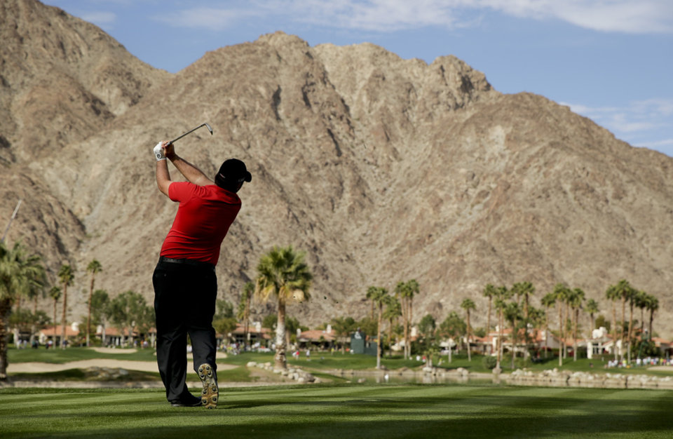 Photo - Patrick Reed watches his tee shot the the fourth hole during the final round of the Humana Challenge golf tournament on the Palmer Private course at PGA West, Sunday, Jan. 19, 2014, in La Quinta, Calif. (AP Photo/Chris Carlson)