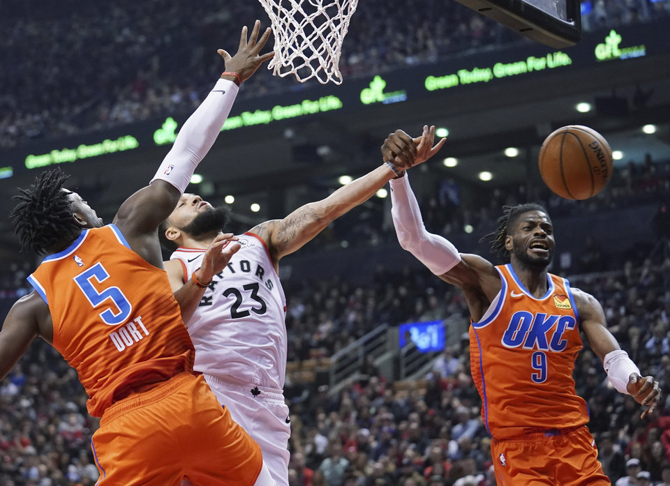 Photo - Toronto Raptors' Fred VanVleet (23) is fouled by Oklahoma City Thunder Nerlens Noel (9) as teammate Luguentz Dort defends during first half NBA basketball action in Toronto on Sunday, Dec. 29, 2019. (Hans Deryk/The Canadian Press via AP)