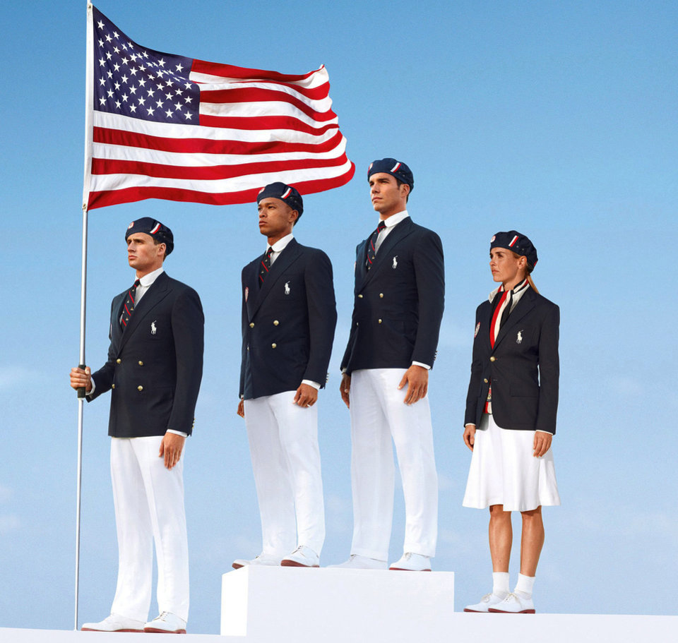 Photo - U.S. Olympic athletes, from left, swimmer Ryan Lochte, decathlete Bryan Clay, rower Giuseppe Lanzone and soccer player Heather Mitts model the official Team USA Opening Ceremony Parade Uniforms.  AP Photo