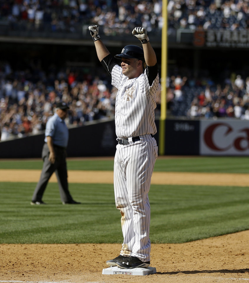 New York Yankees' Brian McCann reacts after his fly ball is dropped, allowing the winning run to score, during the ninth inning of a baseball game against the Cincinnati Reds at Yankee Stadium, Sunday, July 20, 2014, in New York. The Yankees defeated the Reds 3-2. (AP Photo/Seth Wenig)