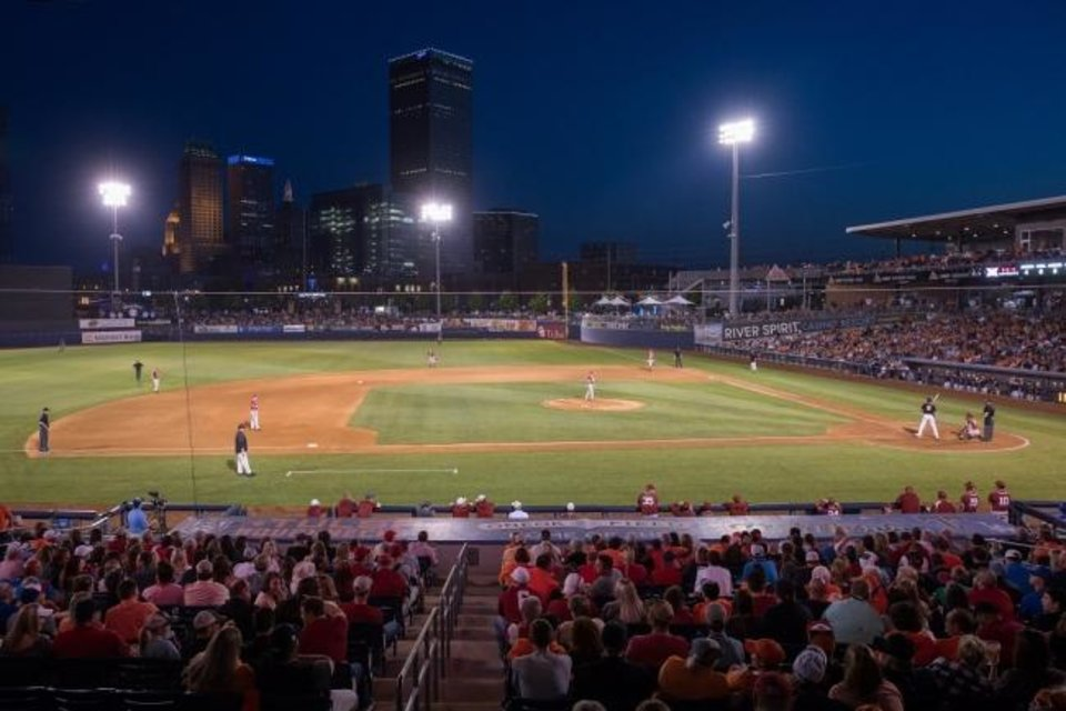 Photo -  Downtown Tulsa is the backdrop for bedlam baseball between Oklahoma State and Oklahoma at ONEOK Field in Tulsa in 2018. Several Tulsa performing arts organizations are using ONEOK Field to put on fall performances due to the coronavirus pandemic. [BRETT ROJO/For the Tulsa World/Archives]