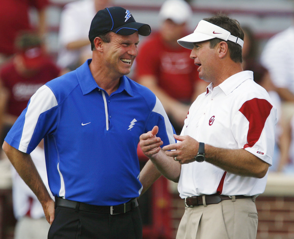 Air Force head coach Troy Calhoun (left) and Sooner head coach Bob Stoops talk before the college football game where the University of Oklahoma Sooners (OU) defeated the Air Force Falcons 27-24 at Gaylord Family-Oklahoma Memorial Stadium on Saturday, Sept. 18, 2010, in Norman, Okla. Photo by Steve Sisney, The Oklahoman
