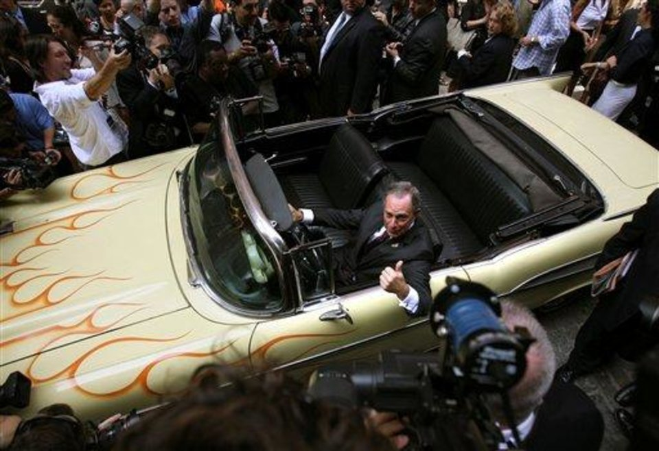 New York  Mayor Michael Bloomberg poses for pictures in a '57 Chevy once owned by Bruce Springsteen  during a news conference in New York, Wednesday, Aug. 13, 2008, announcing the opening of the Rock and Roll Hall of Fame Annex in the Soho section of New York, the first of its kind outside of Cleveland, where the original museum resides.   (AP Photo/Seth Wenig)