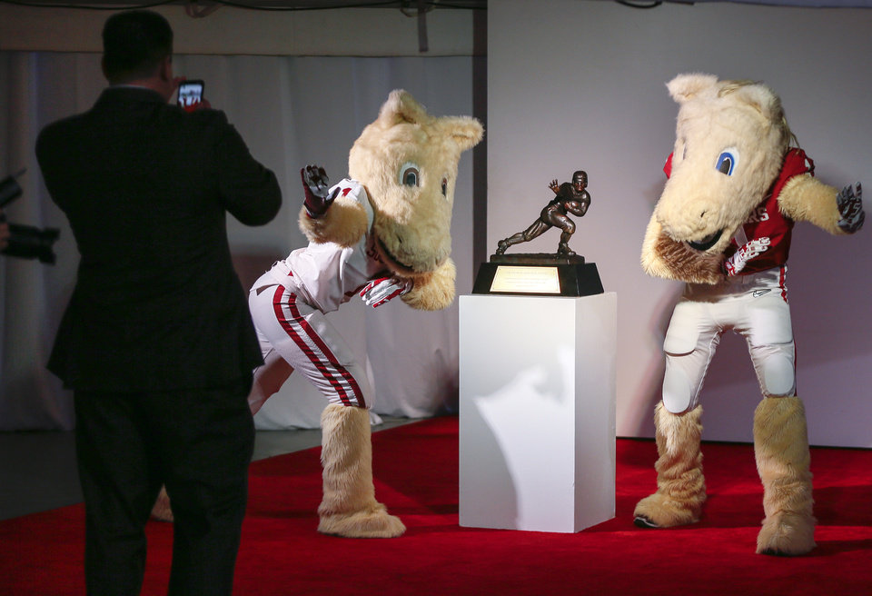 Photo - Mascots Boomer and Sooner with Heisman trophy. PHOTO BY NATE BILLINGS, THE OKLAHOMAN