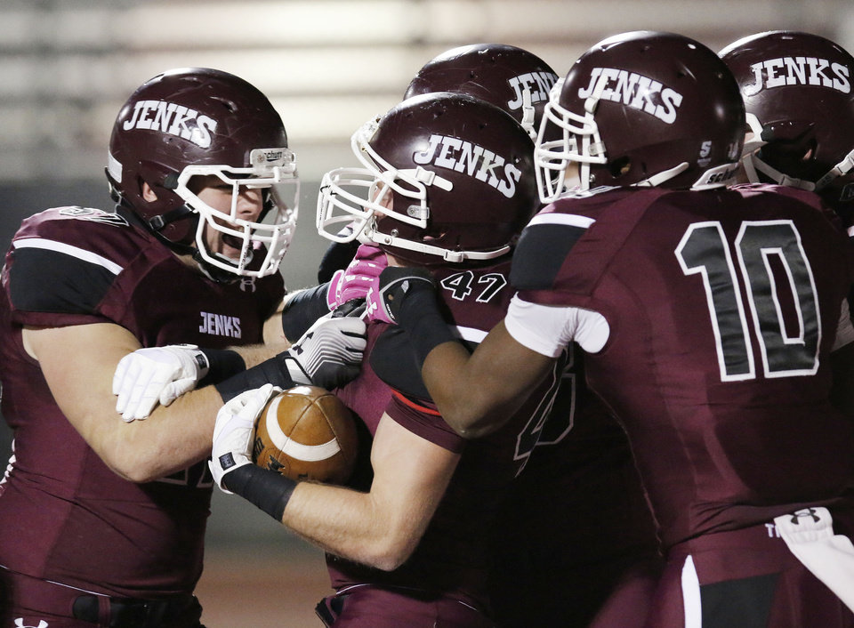 Photo - Jenks teammates surround Riley Waldie (47) after he scored a touchdown during the 6A high school playoff game between Westmoore and Jenks at Yukon High School Friday November 29, 2013. Photo by Doug Hoke, The Oklahoman