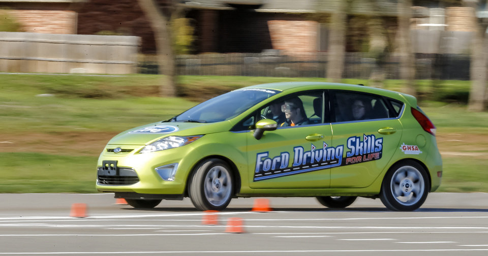 Students drive through the parking lot with 'drunk goggles' on as they try to navigate a course during the Ford Driving Skills For Life interactive course at Yukon High School on Thursday, April 111, 2013, in Yukon, Okla. Photo by Chris Landsberger, The Oklahoman