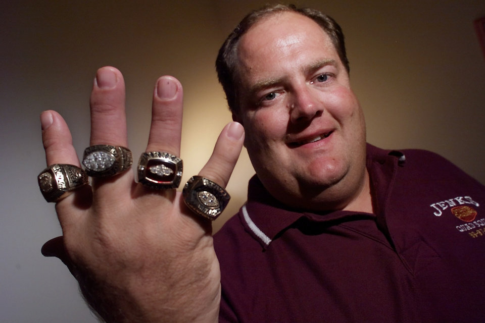 Photo - Jenks high school football coach Allan Trimble has room for one more ring on his thumb to go with his four other championship rings.