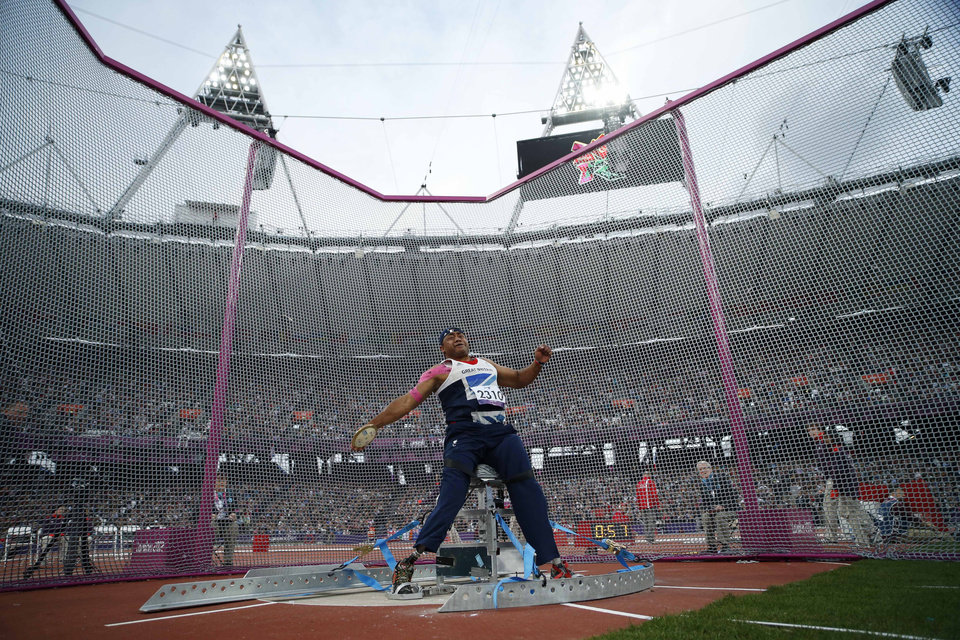 Photo -   Britain's Derek Derenalagi makes a throw in the men's discus throw F57/58 category during the athletics competition at the 2012 Paralympics, Friday, Aug. 31, 2012, in London. Derenalagi, who is originally from Fiji, required amputation on his legs after his vehicle was hit by an improvised explosive device in 2007 whilst serving for the British military in Afghanistan. (AP Photo/Matt Dunham)
